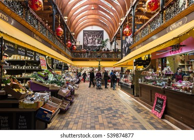 Cork City, Ireland - 19th December 2016:Christmas shoppers walking through the English market in Cork City,The Market open since 1788 is a well know local market popular with locals and tourists alike