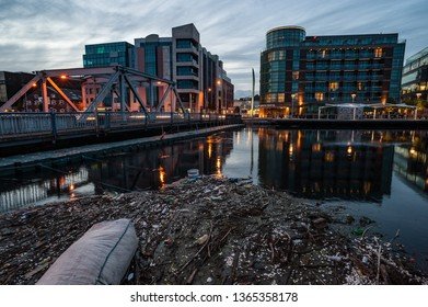 Cork City, Ireland - 20th August, 2012: Empty plastic bottles, polystyrene packing material and general river debris polluting the river Lee in Cork city, Ireland