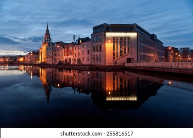 CORK CITY, IRELAND - 20TH AUGUST 2012: Cork City buildings reflected in the river Lee at dusk.