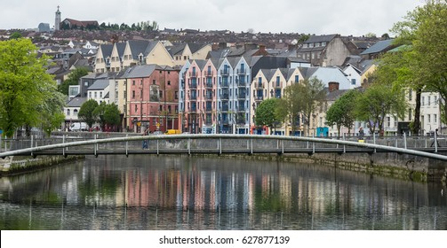 Cork city, Ireland - 23rd April 2017:View of buildings reflected in the water of the river Lee, Cork city, Ireland