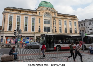 Cork City, Ireland - 24th February  2018: People crossing the street across from Debenhams department store in Cork city, Ireland.