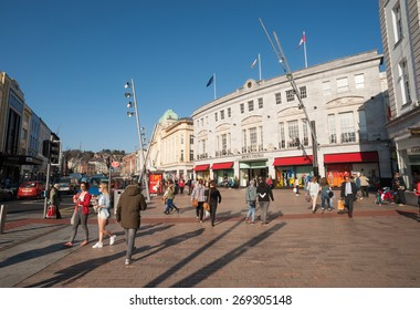 Cork City, Ireland - 28th March 2015: People walking on a busy St Patrick's street, St Patrick's Street is the main shopping street of the city of Cork