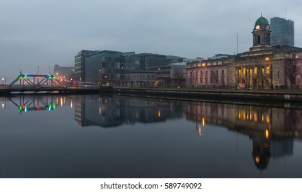 Cork City, Ireland - 29th January 2016: Cork city High tide river reflection during Foggy and cloudy winter evening
