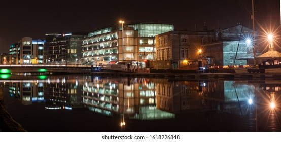 Cork city, Ireland - 30th January 2013: Cork city centre Riverfront Buildings reflected at night in the river Lee.