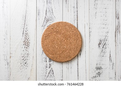 Cork Coaster on white wooden table background
