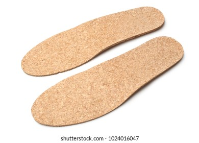 Cork insoles for shoes on white background