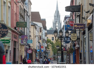 Cork, Ireland/ 09/21/2014- A busy shopping street with the Holy Trinity church behind in Cork
