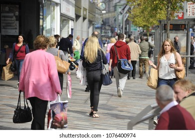 Cork, Ireland/ 09/21/2014- Women shoppers walk along the Grand Parade in Cork on a sunny day