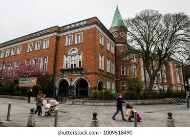 Cork, Ireland - April 13, 2015. People walk with motion blur effect outside the Crawford Art Gallery. The Crawford Art Gallery is a public art gallery and museum.