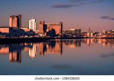 Cork Ireland city center harbor panorama view morning sunrise cold weather calm river water reflection buildings colors