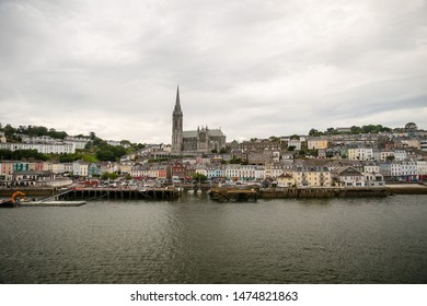Cork, Ireland - July 6, 2019: Cathedral and surrounding downtown buildings of Cork Ireland as seen from the sea.
