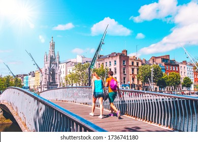 CORK, IRELAND - JULY 6 - Unidentified tourists crossing the Nano Nagle footbridge which was named after Honoria Nano Nagle, who put up schools for children in Cork, July 6, 2013, Cork, Ireland.