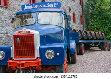 CORK, IRELAND - JUNE 20, 2008:  Loading wooden barrels on old open truck trailer in museum of Irish whiskey at The Jameson Heritage Centre  in Midleton Co. Cork, Ireland on JUNE 20, 2008.