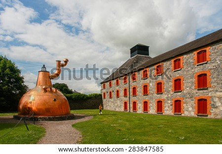 CORK, IRELAND - JUNE 20, 2008:  Old big copper whiskey distillery on stone foundation at the Jameson Heritage Center  in Midleton Co. Cork, 12 miles east of Cork City on the main Cork Waterford Road.
