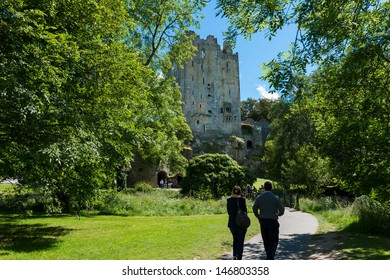 CORK, IRELAND - JUNE 30 - Unidentified couple walking towards the historic Blarney Castle which holds the world famous Blarney Stone, June 30, 2013, Cork, Ireland.