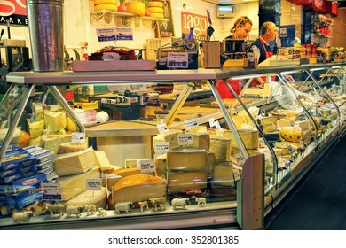 CORK, IRELAND - JUNE, 6 2012: variety of cheese from locals and imported products sold in the famous English market in Cork, Ireland