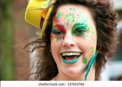 CORK, IRELAND - MARCH 17 - An unidentified woman in a St. Patrick's Day parade with a smile on her face and wearing face paint March 17, 2012, Cork, Ireland.