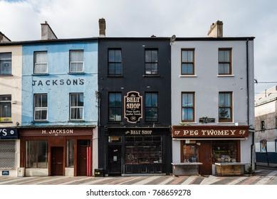 Cork, Ireland - November 12, 2017: Old vintage stores in Cornmarket Street in city center of Cork