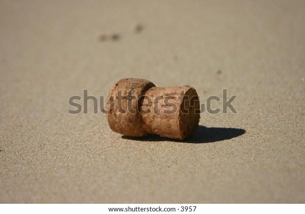 cork on a sandy beach