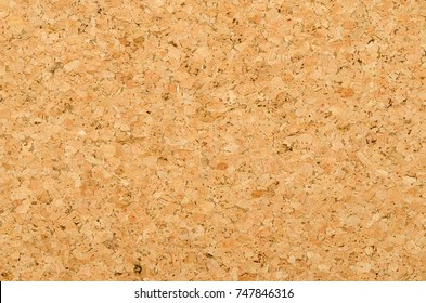Cork sheet surface with coarse texture, comprised of rough grained cork oak, Quercus suber. Decorative panels and veneers, used as bulletin boards, floor and wall tiles. Top view. Photo.