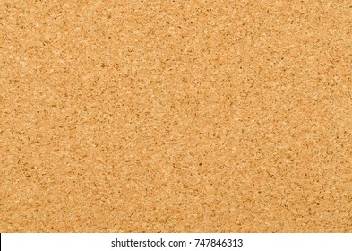 Cork sheet surface with fine texture, comprised of small grained cork oak, Quercus suber. Decorative panels and veneers, used as bulletin boards, floor and wall tiles. Top view. Photo.