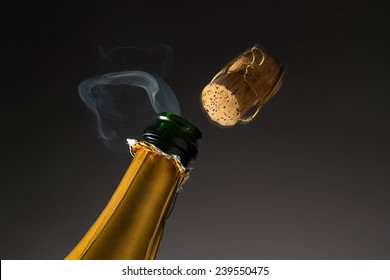 cork shoots out Champagne Bottle with steam