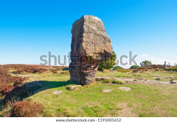 The Cork Stone ancient monolith stands on Stanton Moor in Derbyshire on a bright late summers day.