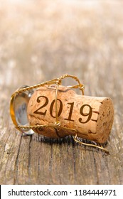 cork stopper of champagne with new year`s date 2019 and copy space