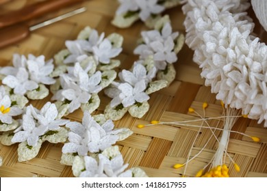 Cork tree flowers crochet and crown flowers crochet with wood crochet needles on weaving texture. Thai crochet garland.