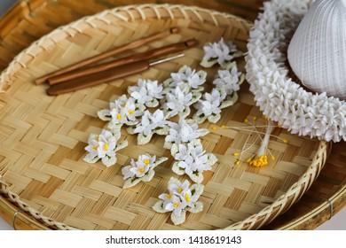 Cork tree flowers crochet and crown flowers crochet with wood crochet needles on basketry texture. Thai crochet garland.