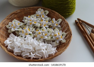 Cork tree flowers crochet and crown flowers crochet with wood crochet needles on white background. Thai crochet garland.