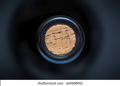 cork in the wine bottle and blurry background, photographed from above for winemaker business card or book cover
