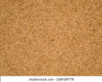 Corkboard background. Brown paper texture. Abstract pattern. Wood backdrop. Cardboard wall. Plywood.