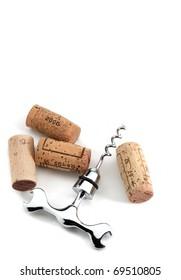 Corks and corkscrew over white