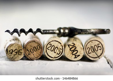 Corks of different wine years and corkscrew