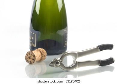corkscrew, a cork and a bottle