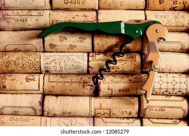 Corkscrew on wine corks arranged in rows