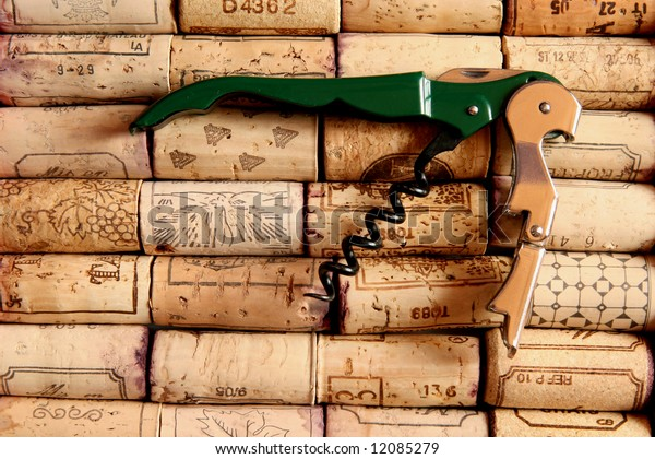 Corkscrew on wine corks arranged in rows