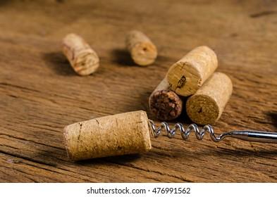 corkscrew for open winecork on wooden background