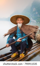 Cormorant fisherman and his birds on the Li River in Yangshuo