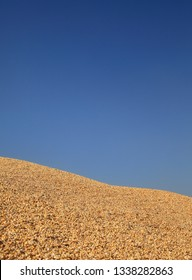 Corn background, heap of corn crop after harvest with clear blue sky, selective focus and  copy space