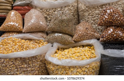 Corn, beans, and lentils for sale in South American market.