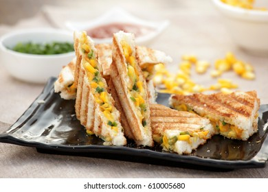 Corn and Cheese sandwich is a delicious, super easy, tasty sandwich. Boiled corn kernels are mixed with white sauce and spices and grilled to a perfection.