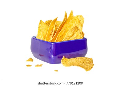 Corn chips nachos in a blue ceramic bowl on a white background. Side view. Isolated