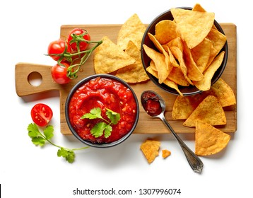 corn chips nachos and salsa sauce isolated on white background, top view