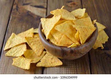 Corn chips on a brown background