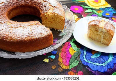Corn cob bund cake, with rompope icing, over a embroidered mexican tablecloth