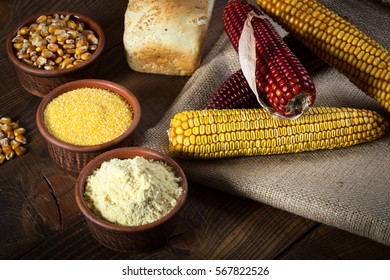 Corn cobs, seeds, groats, flour and bread , raw food concept
