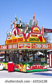 corn dog and lemonade concessions stand at a carnival
