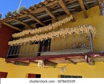 corn drying in the sun on balcony in Pero - Shutterstock ID 1878635539